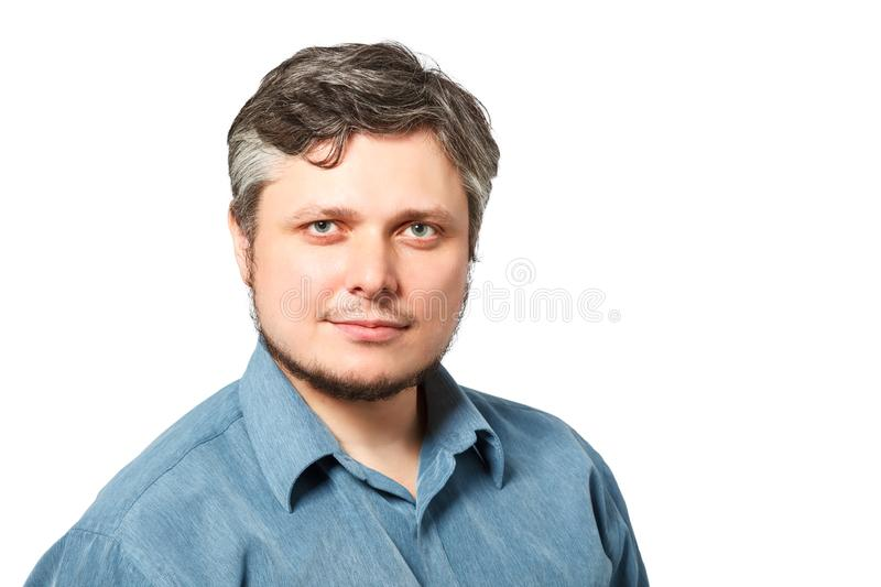 Handsome caucasian man smiling portrait on white isolated background with blue shirt with copy space royalty free stock photos