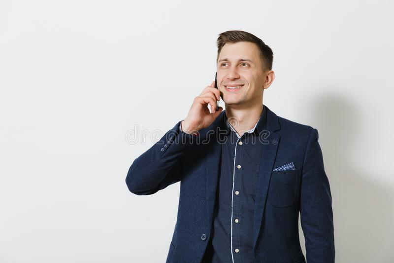 Handsome caucasian young business man isolated on white background. Manager, worker. Copy space for advertisement royalty free stock image