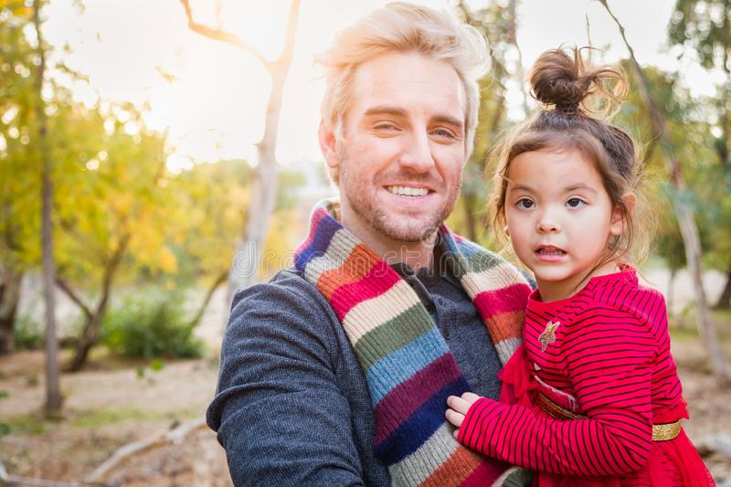 Handsome Caucasian Young Man with Mixed Race Baby Girl Outdoors royalty free stock photography