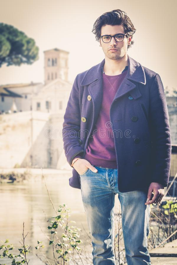 Handsome portrait man outdoor. Model hair and clothing style. stock image