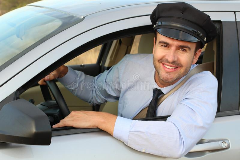 Handsome chauffeur smiling at camera stock image
