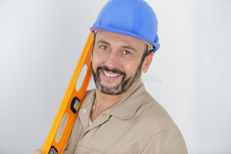 Handsome cheerful male engineer smiling to camera. Handsome cheerful male engineer smiling to the camera royalty free stock photography