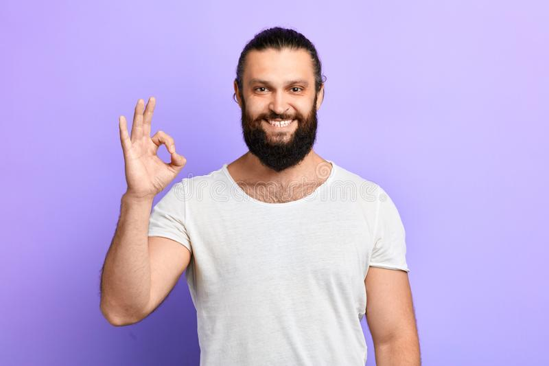 A handsome cheerful positive man expresses positive emotion stock image