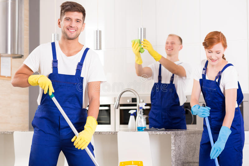 Handsome cleaner with friends stock photos