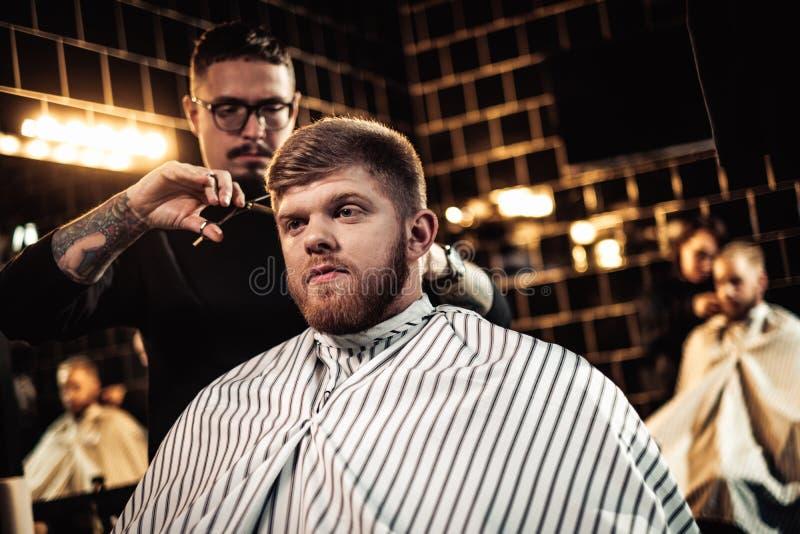 Client in barber shop. Handsome client in barber shop stock image
