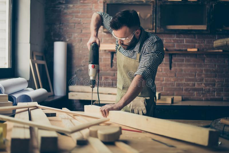 Handsome concentrated professional serious handsome bearded wear stock image