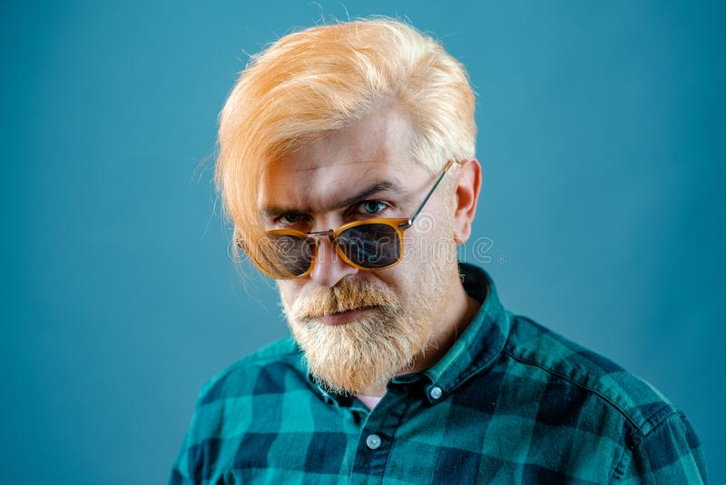 Handsome confident perfect hairstyle man indoor. Head and shoulders portrait of a bearded middle-aged man looking at the royalty free stock images