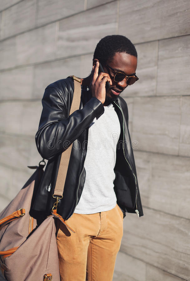 Handsome confident young african man talking on smartphone royalty free stock photo