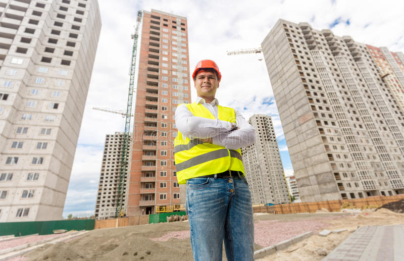 Handsome construction engineer standing on building site royalty free stock photos