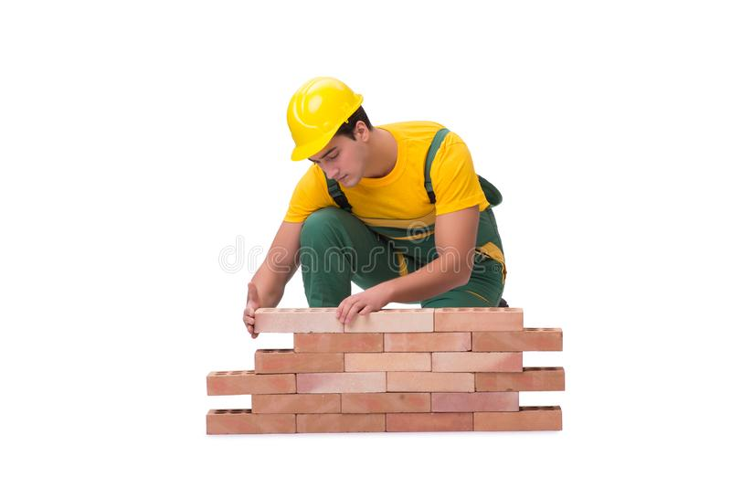 The the handsome construction worker building brick wall stock images