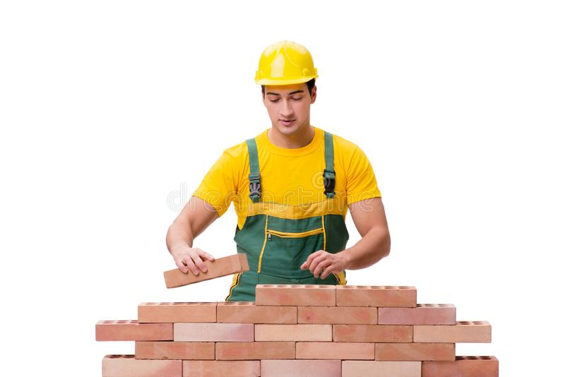The the handsome construction worker building brick wall stock image