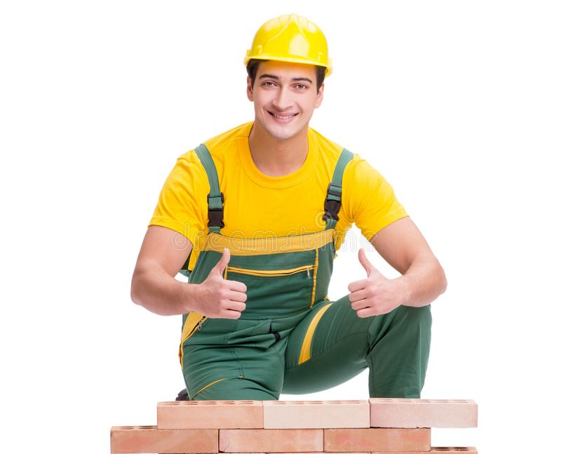 The handsome construction worker building brick wall royalty free stock photography