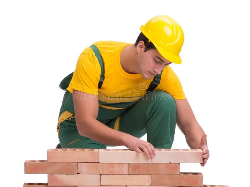 The handsome construction worker building brick wall royalty free stock image