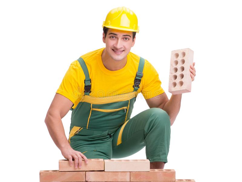 The handsome construction worker building brick wall stock photos