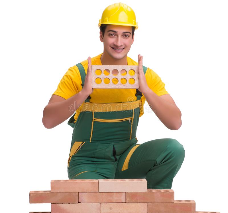 The handsome construction worker building brick wall royalty free stock photos