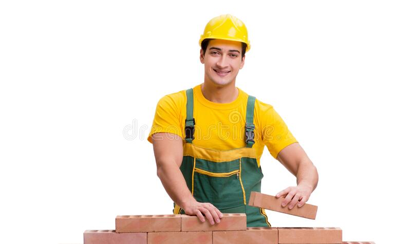 The handsome construction worker building brick wall stock images