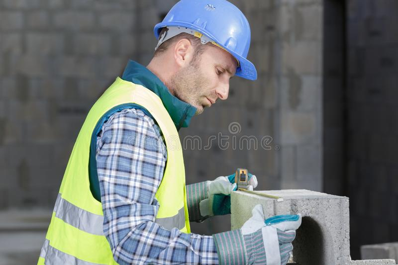 Handsome construction worker in construction site royalty free stock photography