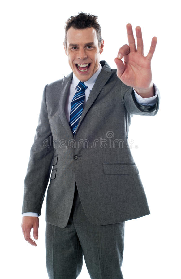 Handsome Corporate Man Gesturing Excellent Royalty Free Stock Image