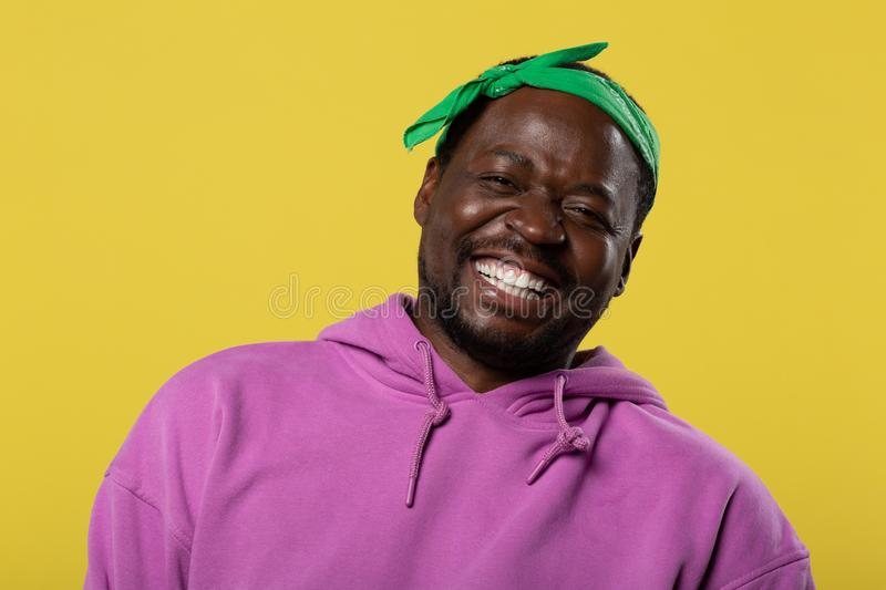 Handsome dark-skinned man demonstrating his real emotions royalty free stock photos