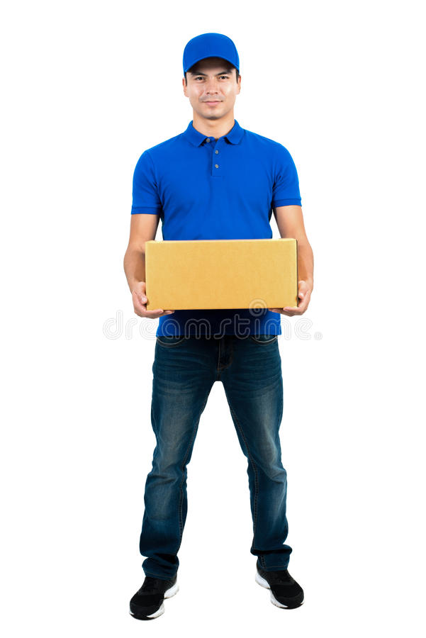 Handsome delivery man holding parcel box royalty free stock images