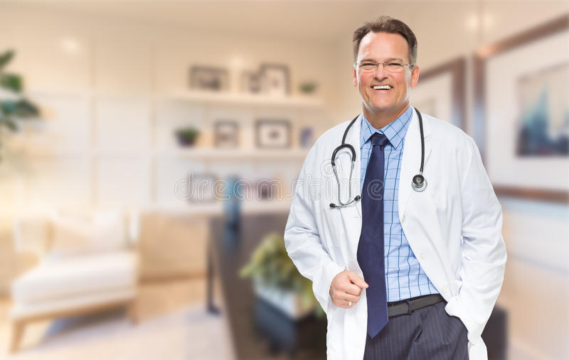 Handsome Doctor or Nurse Standing In His Office royalty free stock images