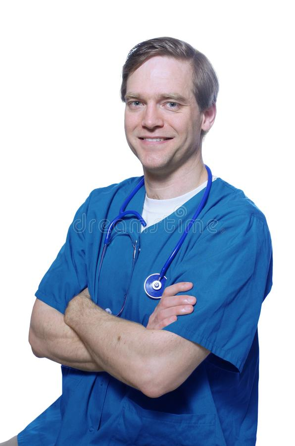 Handsome doctor smiling with arms crossed royalty free stock image