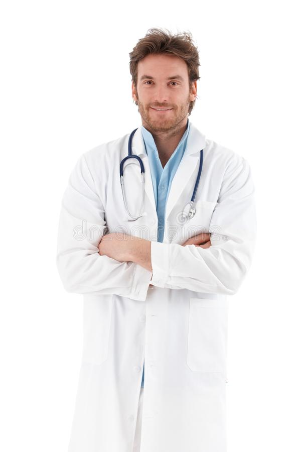Download Handsome Doctor Standing Arms Crossed Smiling Royalty Free Stock Photo - Image: 22199255