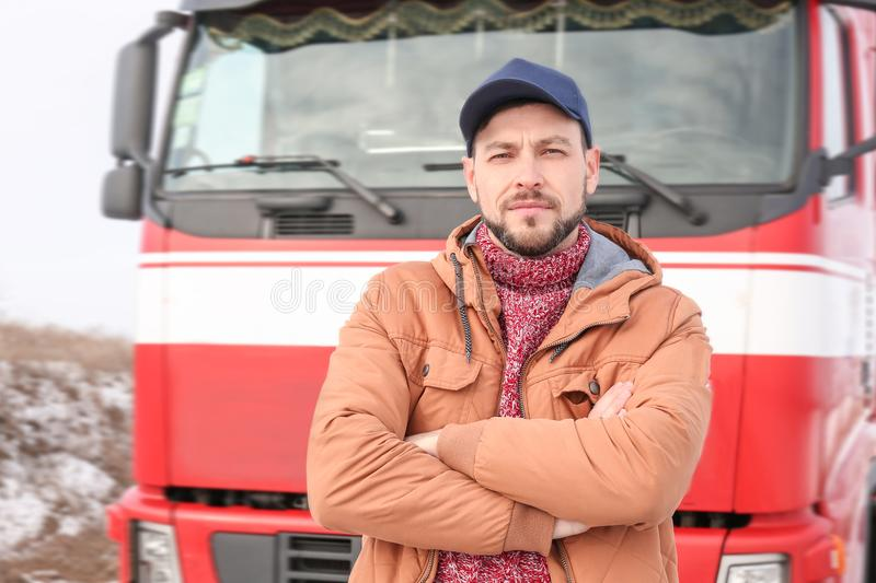 Handsome driver near big modern truck. Outdoors stock images