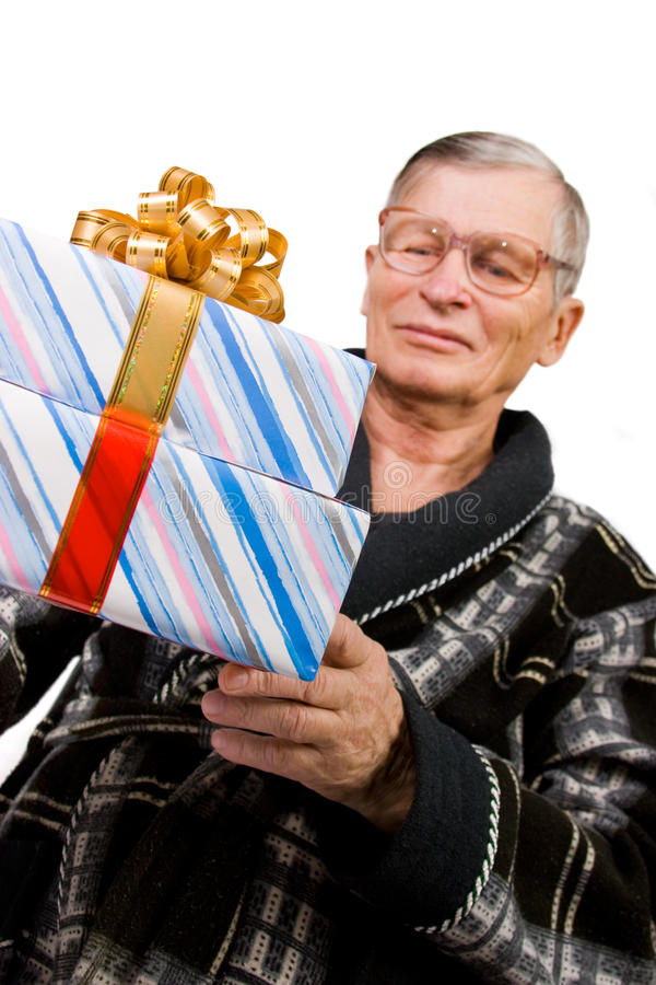 Download Handsome Elderly Man Holding Gift Boxes Stock Photo - Image: 12152852