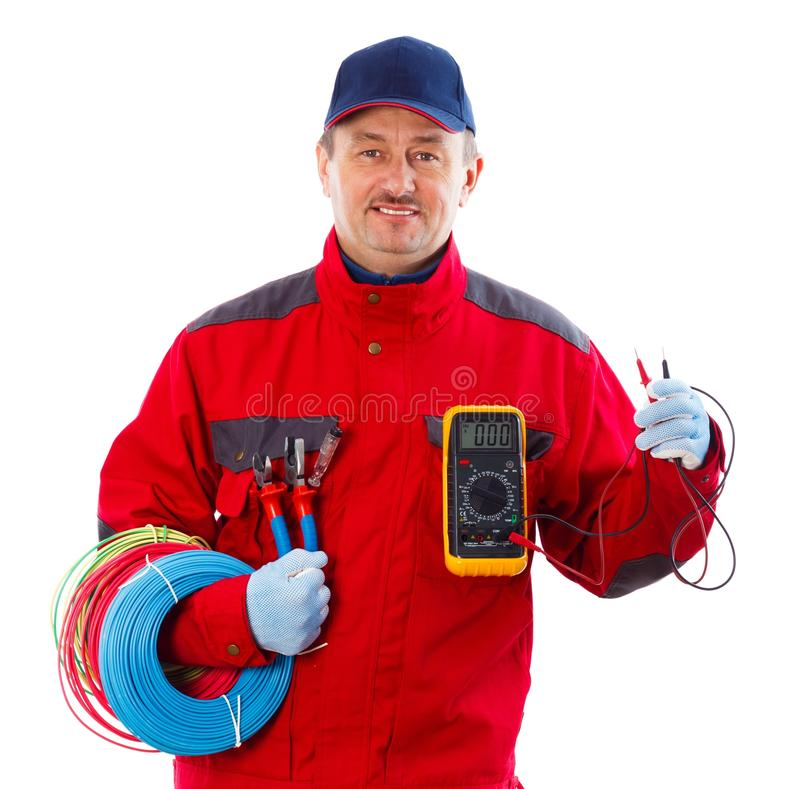 Handsome Electrician. Handsome confident electrician with electrical equipment royalty free stock photography