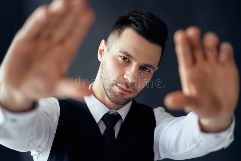 Handsome elegant man looking through a finger frame stock images