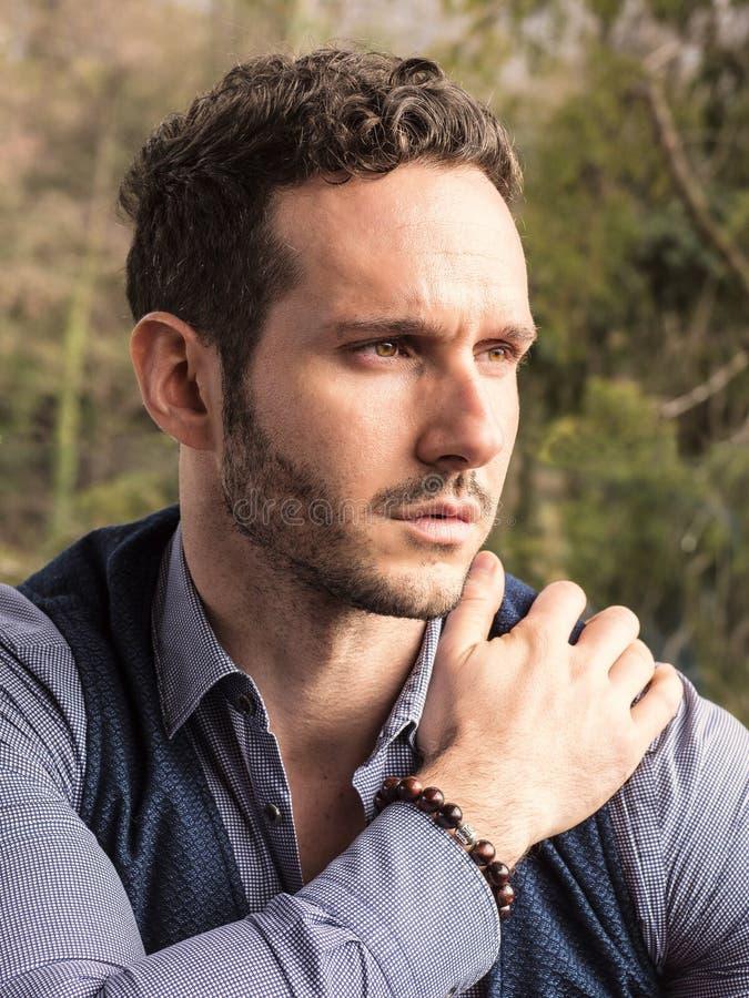 Handsome elegant man outdoor, wearing shirt and vest stock photo