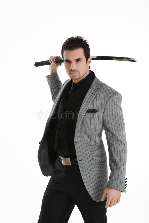 Handsome elegant man with sword royalty free stock photo