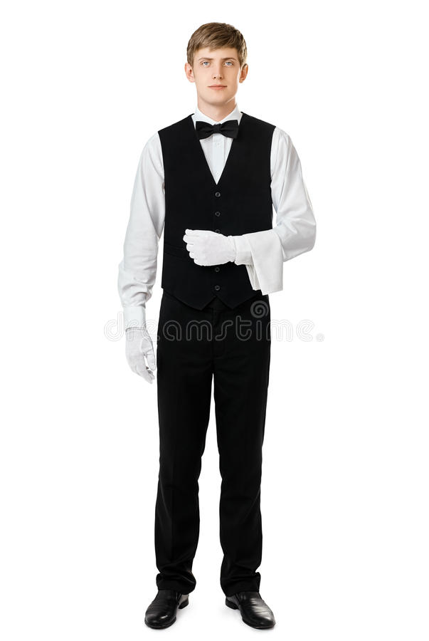 Handsome elegant waiter with towel over arm royalty free stock photography