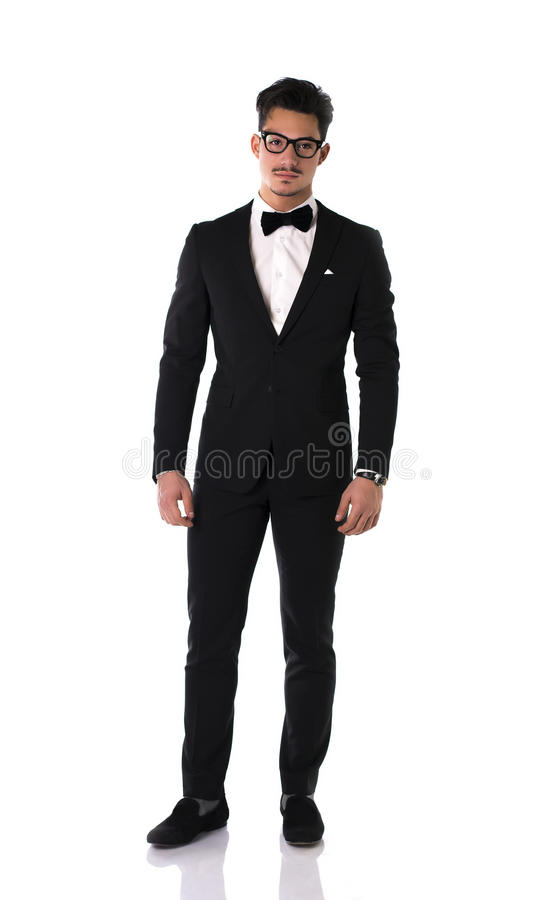 Handsome elegant young man with suit and bow-tie stock photography