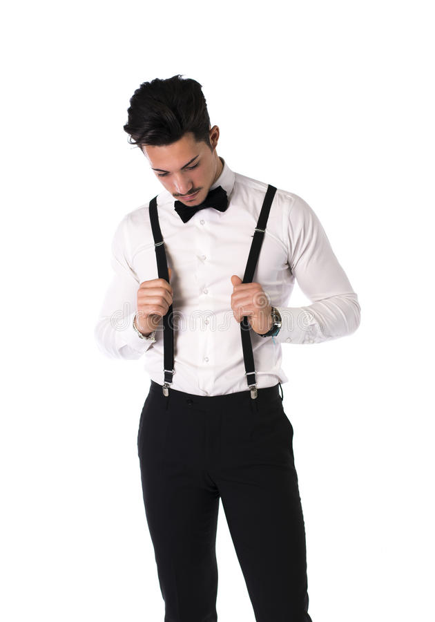 Handsome elegant young man with suit, bow-tie and moustache stock photo