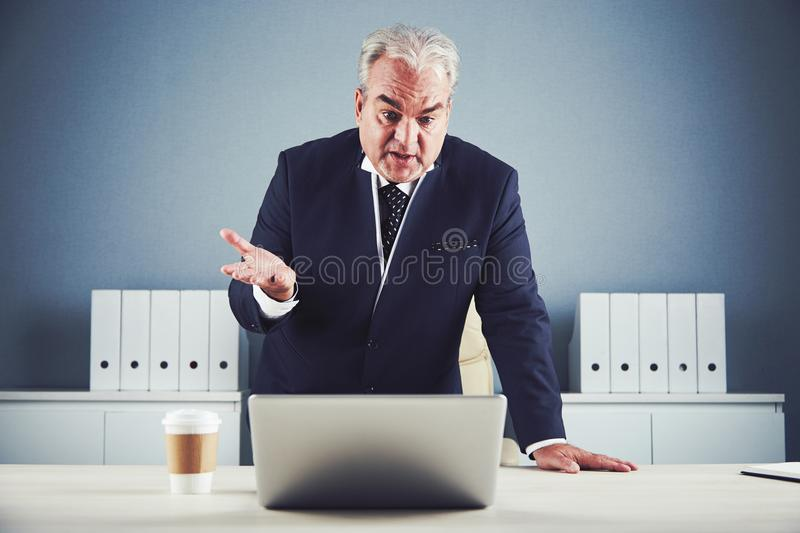 Mature businessman talking using video chat royalty free stock images
