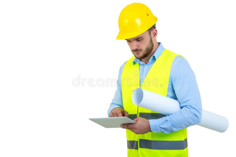 Handsome engineer working with a tablet pc, isolated on white stock image