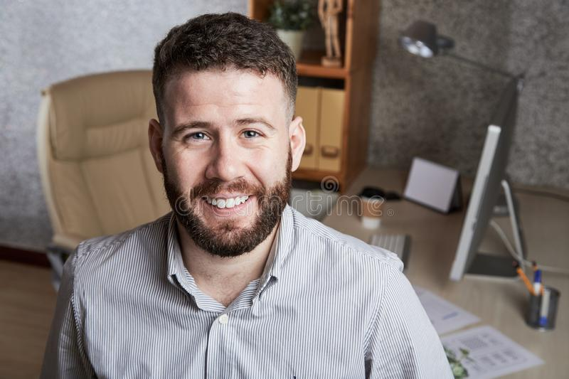 Handsome entrepreneur. Portrait of young handsome entrepreneur in his office stock photos