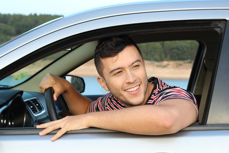 Handsome ethnic driver looking at view royalty free stock photos