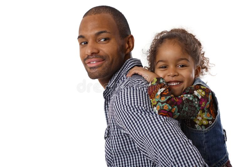 Handsome ethnic father and little girl piggyback stock photos