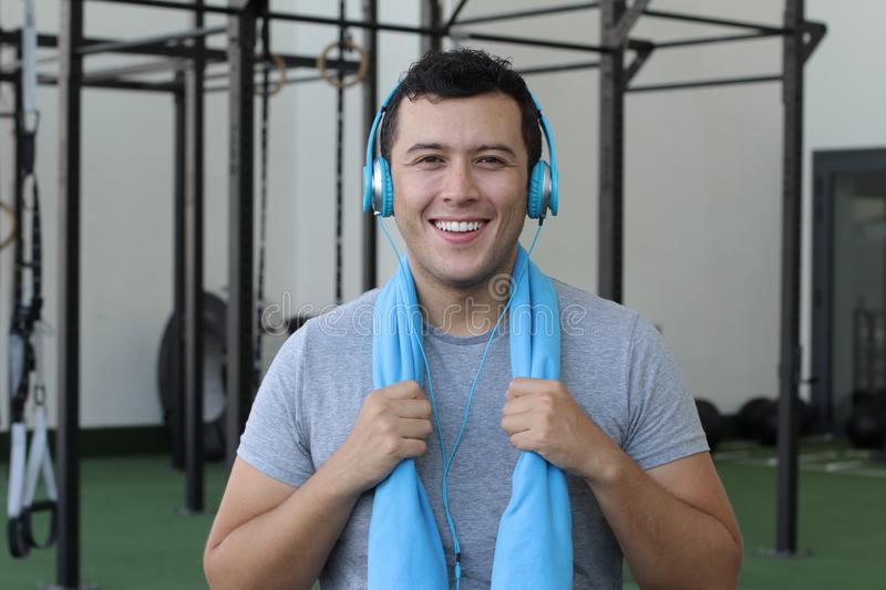Handsome ethnic man satisfied after a good workout stock photography