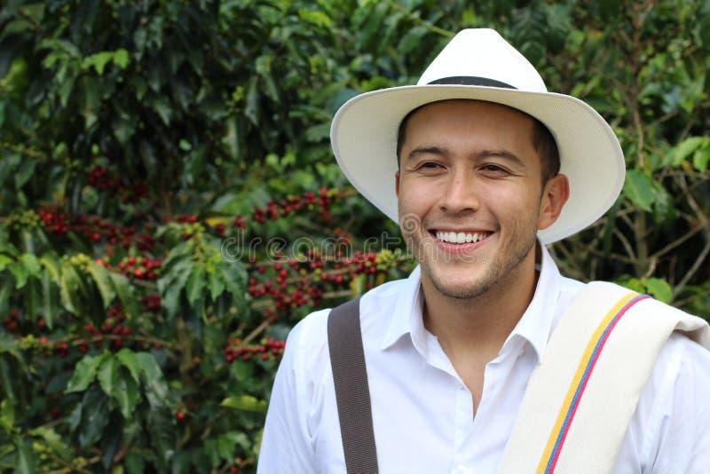 Handsome farmer in coffee plantation stock photo