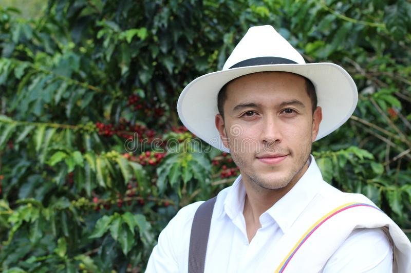 Handsome farmer in coffee plantation stock image