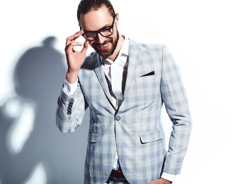 Handsome fashion stylish businessman model dressed in elegant suit. Portrait of handsome fashion stylish hipster businessman model dressed in elegant light blue stock photography