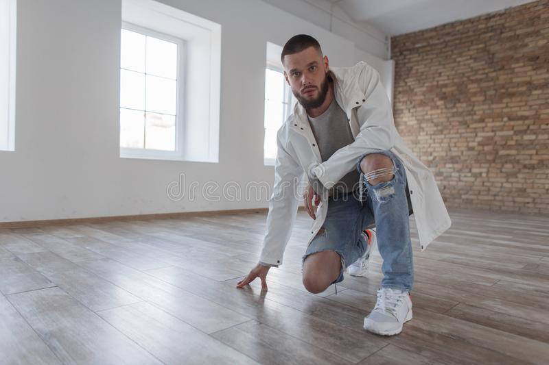 Handsome fashionable young attractive man in a fashionable stock photo