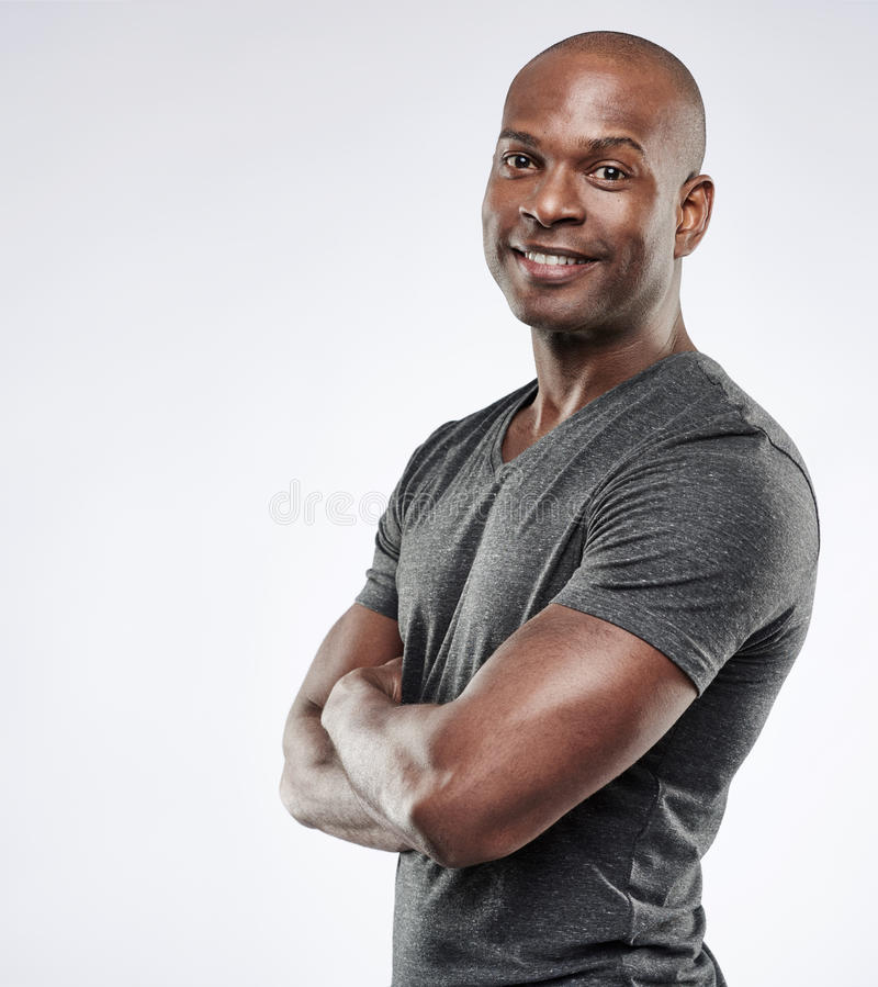 Handsome fit man with folded arms royalty free stock photos