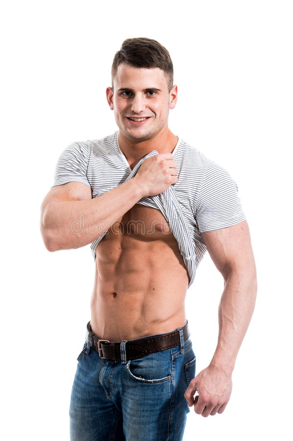 Handsome fit young man pulling up t shirt revealing abs for Buff dudes t shirt