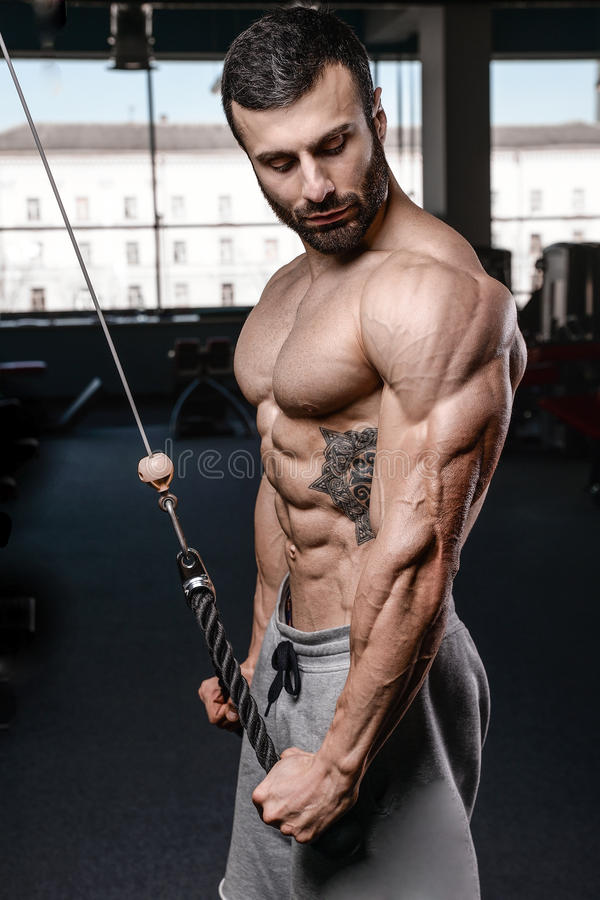 Handsome fitness model train in the gym gain muscle. Healthcare lifestyle caucasian man bodybuilder work out naked body stock photos