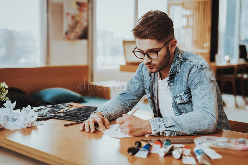 Handsome Freelance Male Artist Painting on Pape stock photo
